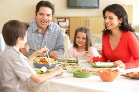 Young Family Enjoying Meal At Home in a furnished short term rental